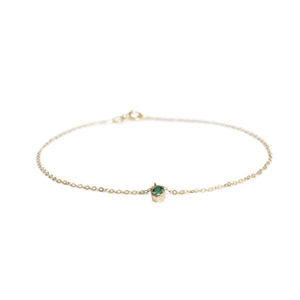 tyndt guldarmbånd smaragd